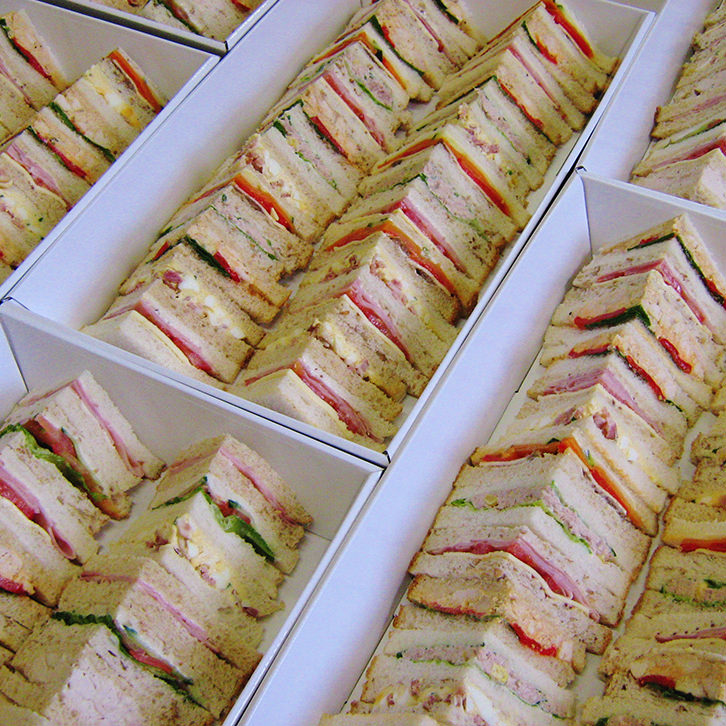 Traditional Triangle Sandwiches for your event by Devour It catering Melbourne
